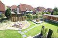 Blick in den Garten mit Carport