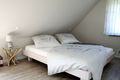 Doppelbetten mit Nachtischen